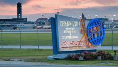 New Orleans Airport Sign Illuminated in Early Evening Stock Footage