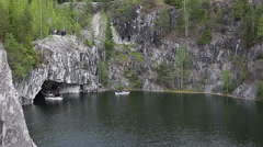 Ruskeala inundated marble quarry with boating, view from trekking way. Karelia Stock Footage