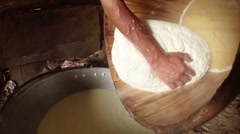 Large piece of feta cheese in a wooden tub decanted from residual Stock Footage