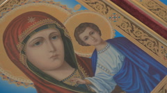 Madonna (Mary) of Jerusalem and a child (Jesus Christ) on mahogany and gold Stock Footage