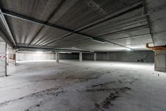 Inside of empty underground parking Stock Photos