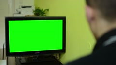 Man watches TV(television) - green screen - stock footage