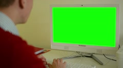 Man works on computer - green screen - office - closeup Stock Footage