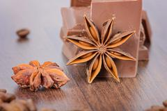 Milk chocolate, coffee beans and anise - stock photo