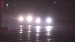 Snow and wind blowing the snow at night in late autumn snow storm Stock Footage