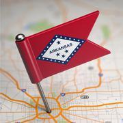 Arkansas Small Flag on a Map Background. Stock Illustration
