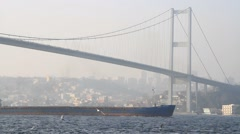 Air pollution in Istanbul. Smog with a cargo ship passing in Bosporus - stock footage