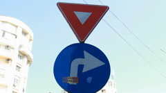 Yield And To The Right Sign, Traffic, Summer Day, Urban Setting Stock Footage