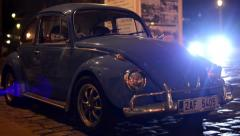 night vintage car - night urban street with cars - car headlights - stock footage