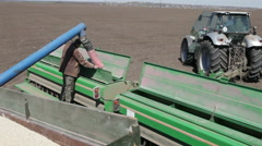 Grain is poured into the drill Stock Footage