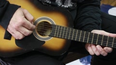 Hand stumming acoustic guitar Stock Footage