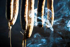 Smoked and suspended sausage in forester's lodge Stock Photos
