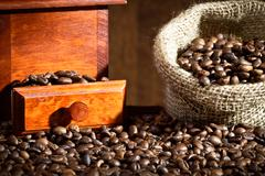 coffee grinder with coffee beans sack - stock photo