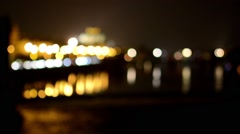 night city (night urban street with cars) river - lamps and headlights - blurred - stock footage