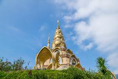 golden pagoda at wat phra that pha son kaew - stock photo