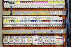 Stock Photo of control panel with static energy meters and circuit-breakers (fuse)