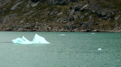 Greenland Prince Christian Sound 015 small iceberg in turquoise ice water Stock Footage