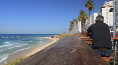 City beach bat yam, the man looks at the sea on the seashore Stock Footage