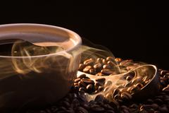 Dry coffee with golden smoke Stock Photos