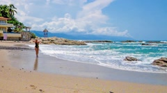 Woman coming out of Pacific ocean at beach in Mexico - stock footage