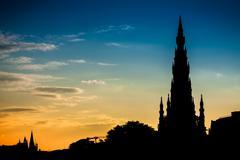 scott monument in edinburgh and summer sunset - stock photo