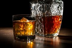 Carafer and glass with ice with whisky Stock Photos