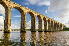 old stone railway bridge in berwick-upon-tweed - stock photo