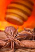 honey dipper, star anise and cinnamon bark - stock photo