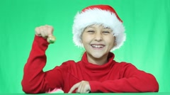Girl in a Santa Claus hat  calls the  bell Stock Footage