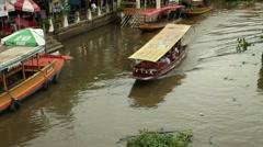 Bangkok, Thailand - June  13, 2014: Tourist  boat at  Amphawa Floating Market Stock Footage