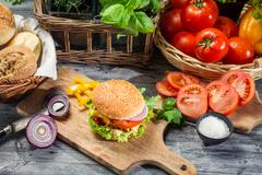 Fresh vegetables and herbs as ingredients for homemade hamburger Stock Photos