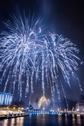 Spectacular blue fireworks at night Stock Photos