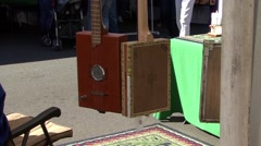 Guitar Square in Market Stock Footage