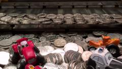 Arcade / Amusement Coin Pusher Machine - Silver Coins With Prizes 1080p Stock Footage