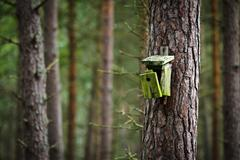 old broken birdhouse in forest - stock photo