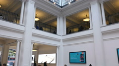 Apple Store interior showing several floors and screens Stock Footage