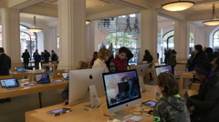 Apple Store interior with people on iMacs Stock Footage