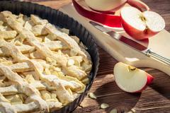 Closeup of freshly peeled apples and apple pie Stock Photos