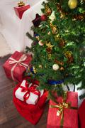 four gifts with christmas tree in xmas - stock photo