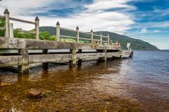 Old harbor over loch ness in scotland Stock Photos