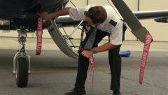 Pilot Attaches Post-Flight Safety Covers and Ribbons Remove Before Flight 4K UHD Stock Footage
