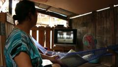 Parents cradling their baby sleeping in a hammock, Culture of Thailand Stock Footage