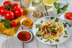 ingredients and fresh vegetables to spaghetti - stock photo
