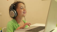 Young girl enjoy educational game on her laptop Stock Footage