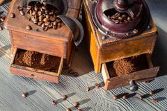Ground coffee in the old-fashioned grinders Stock Photos