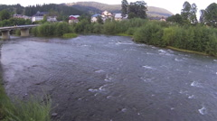 river in mountain settlement. Aerial  - stock footage