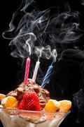 Blown off candle on birthday ice cream Stock Photos