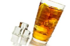 cold tea in glass and ice cube - stock photo