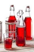 closeup of vintage bottles with juice on white background - stock photo