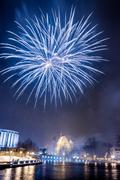 Big blue fireworks over the river at night Stock Photos